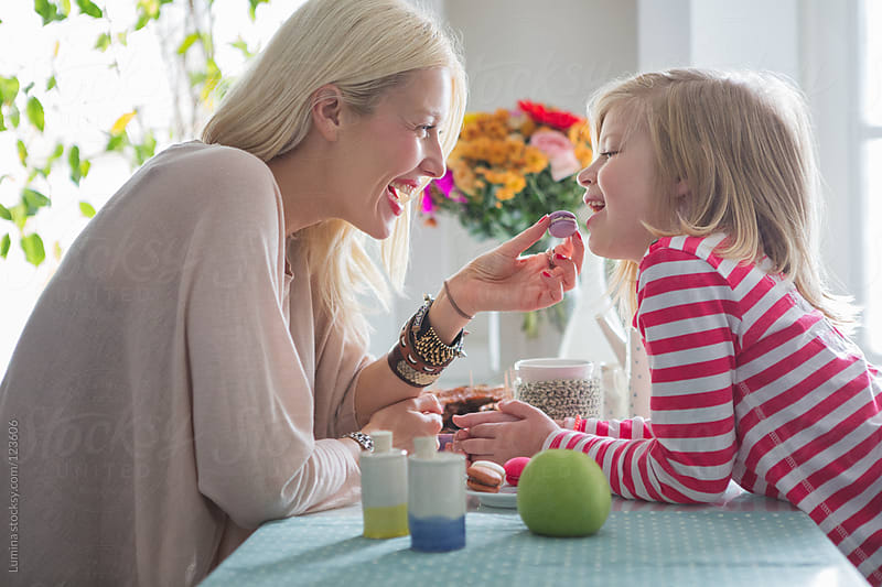 Mother and Daughter Eating Macarons by Lumina for Stocksy United