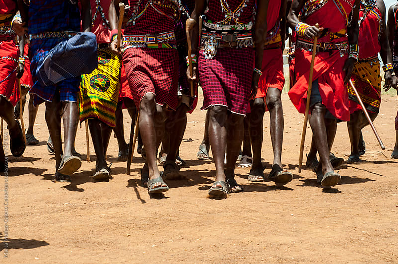 Maasai tribesmen in the Maasai Mara National Park. by Marta Muñoz-Calero Calderon for Stocksy United