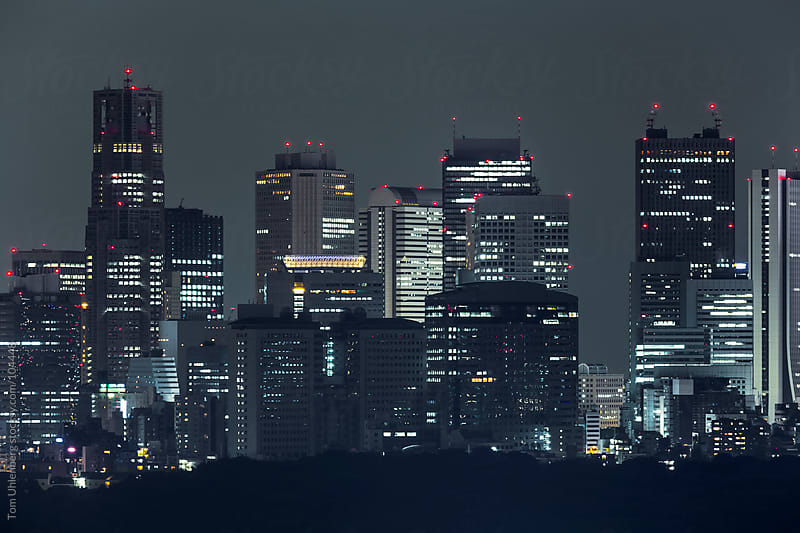 Tokyo at Night - Skyscrapers of Shinjuku as Seen from Shibuya by Tom Uhlenberg for Stocksy United