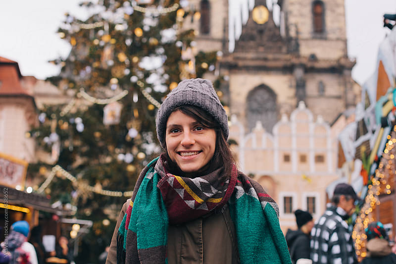 Beautiful happy woman in the city center during Christmas time  by Marija Mandic for Stocksy United