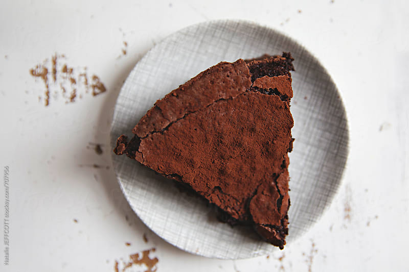 flour less chocolate cake for afternoon tea on a vintage plate by Natalie JEFFCOTT for Stocksy United