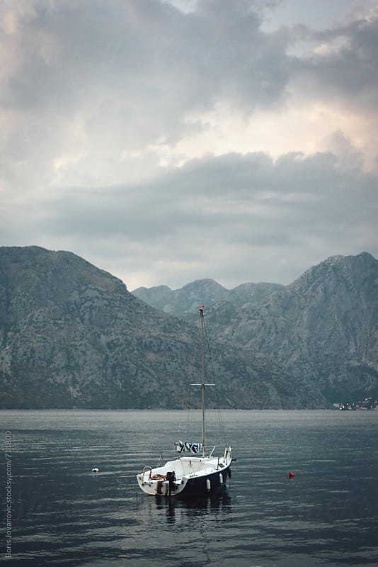 Empty boat on beautiful landscape by Boris Jovanovic for Stocksy United