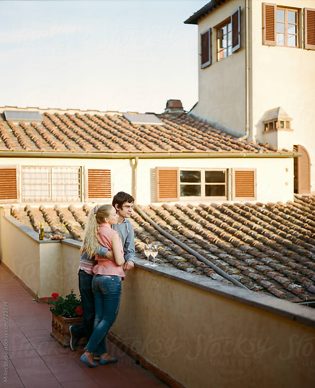 Couple dating on a roof by Milles Studio for Stocksy United