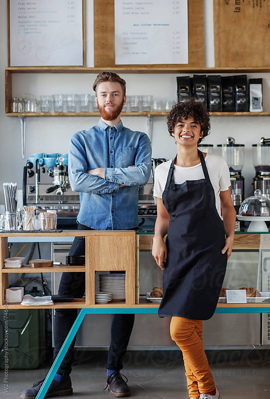 Two young owners in their coffee bar by W2 Photography for Stocksy United