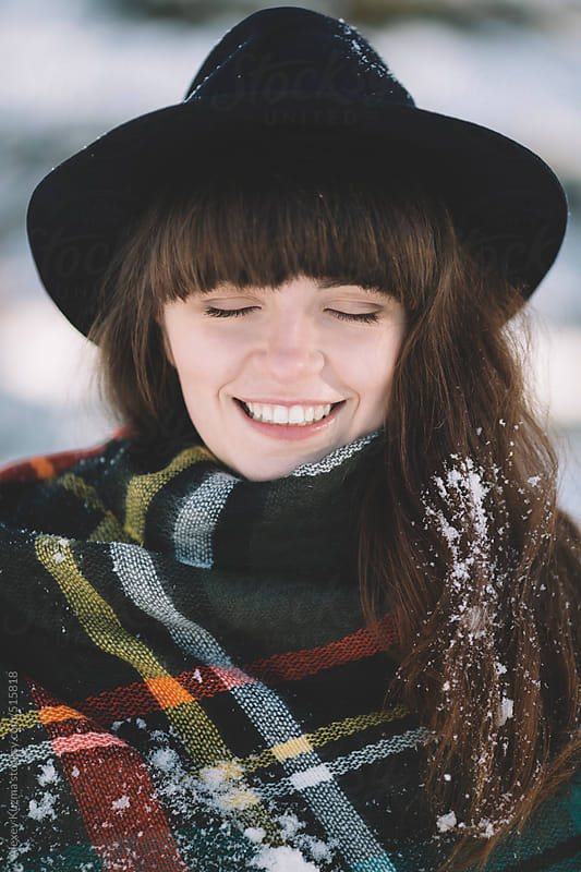happy winter portrait of the young woman with hat . by Alexey Kuzma for Stocksy United