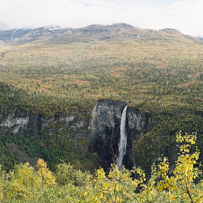 Vettisfossen waterfall in Utladalen valley in Norway rough autumn leaves by Atle Rønningen for Stocksy United