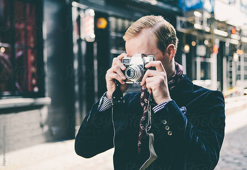 Young man taking pictures in London by kkgas for Stocksy United