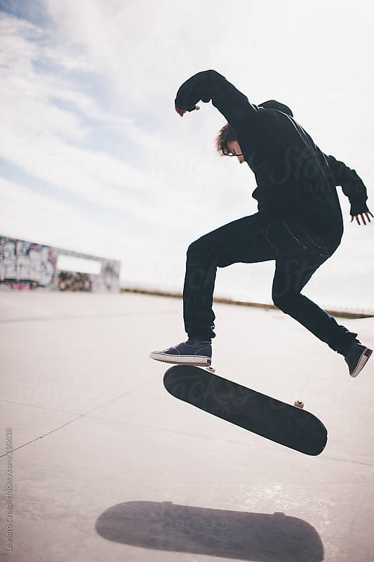 Skater performing trick by Leandro Crespi for Stocksy United