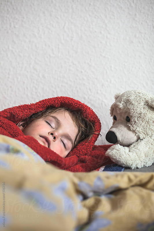 Preschooler taking nap after a bath by Mima Foto for Stocksy United