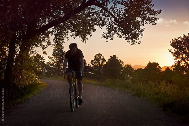 sunset ride by Tod Kapke for Stocksy United
