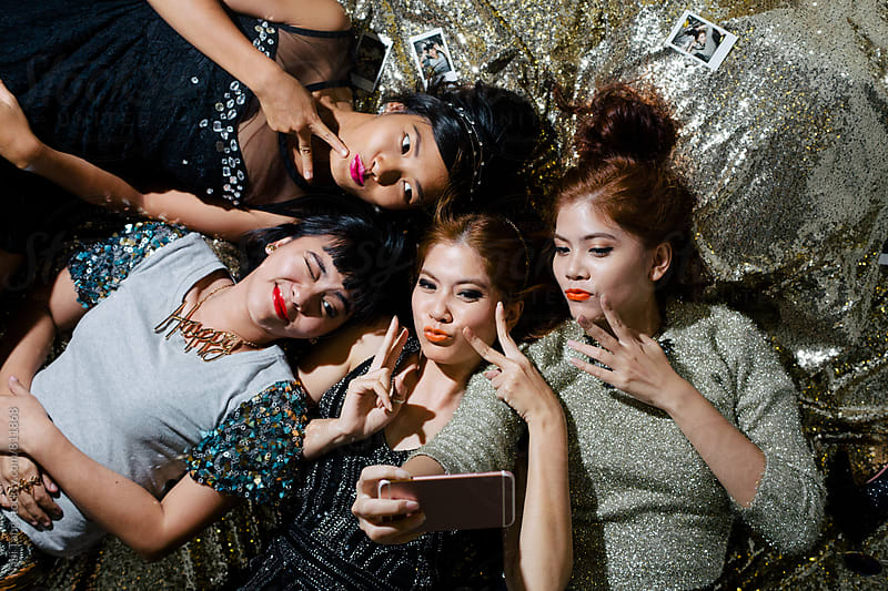 Asian young women making selfie together in the party by Nabi Tang for Stocksy United