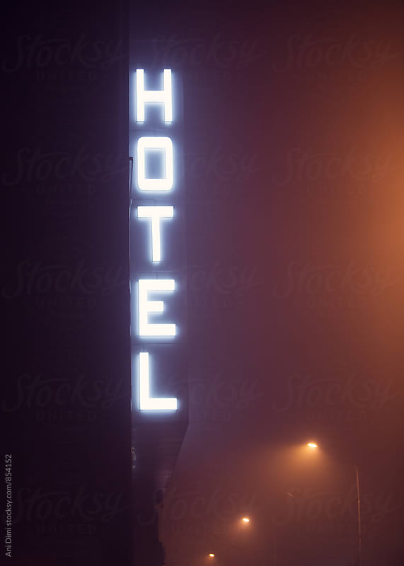 Hotel sign during the night by Ani Dimi for Stocksy United