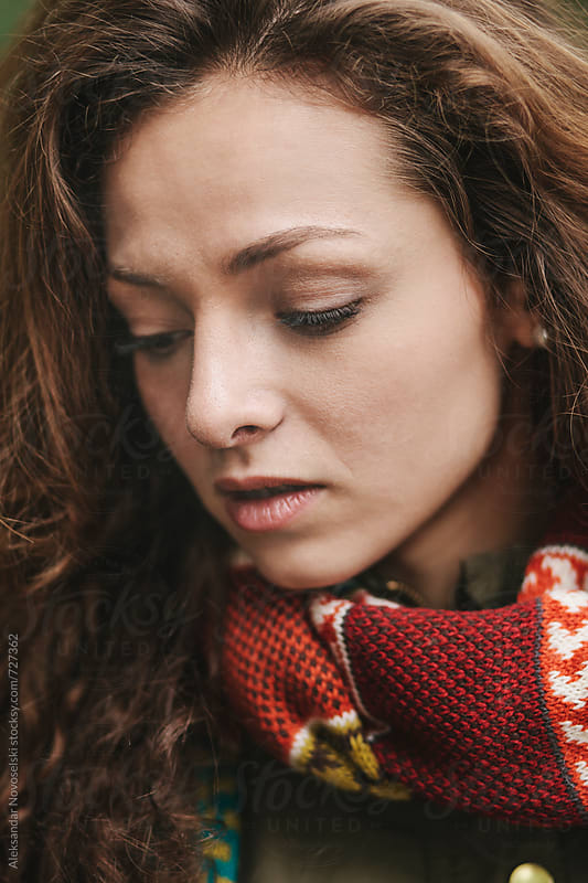 Sensual portrait of beautiful woman with scarf, outdoors by Aleksandar Novoselski for Stocksy United