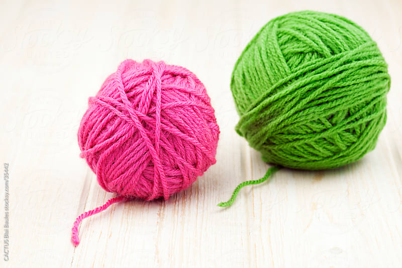 Two balls of yarn by CACTUS Blai Baules for Stocksy United
