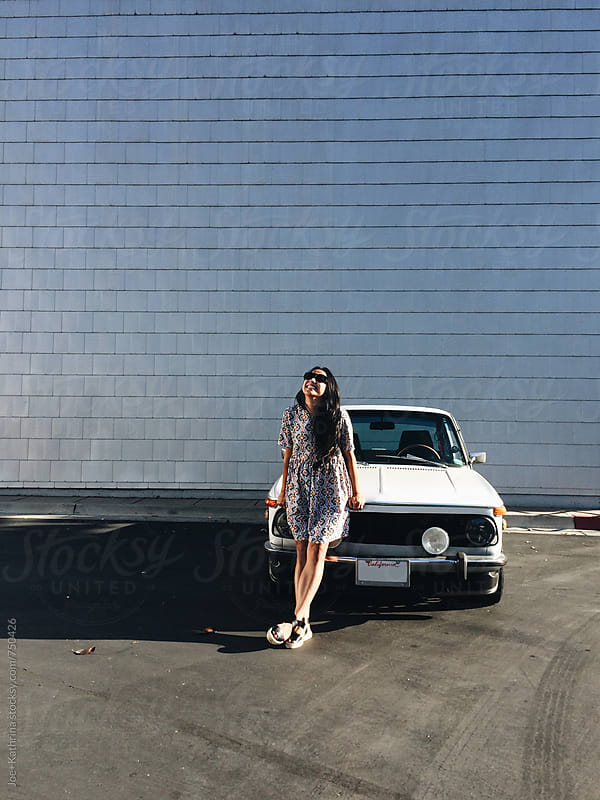 girl standing in front of car by Joe+Kathrina for Stocksy United