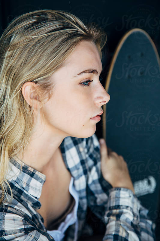 Portrait of a girl and skateboard by Curtis Kim for Stocksy United