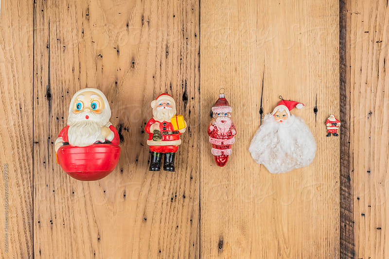 Collection of Christmas Santa Ornaments and Decorations by suzanne clements for Stocksy United