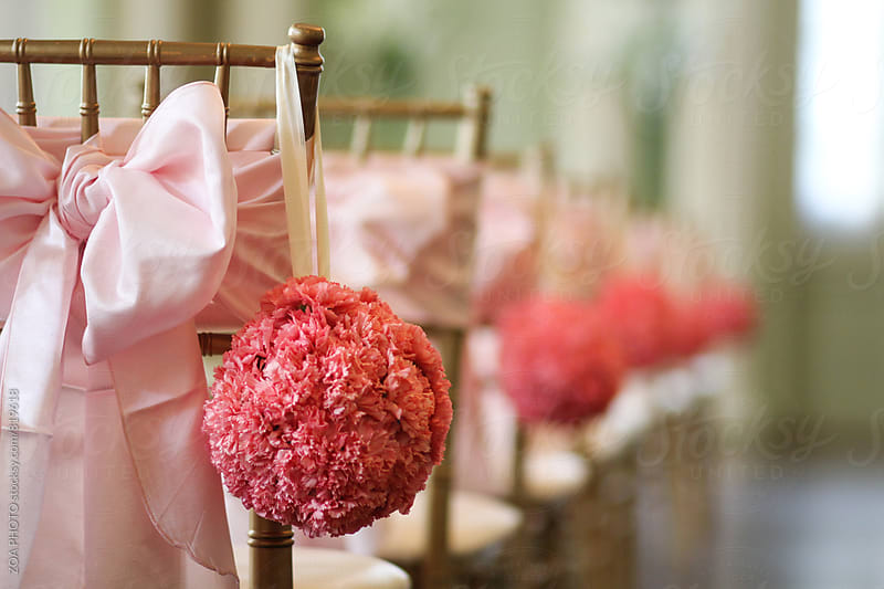Wedding ceremony chairs with pink lower balls by ZOA PHOTO for Stocksy United
