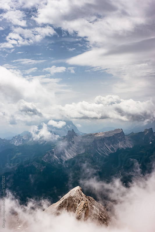 Mountain Peak over Clouds, Italian Dolomites by Giorgio Magini for Stocksy United