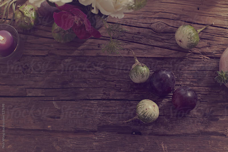 Scattered Plums on Rustic Table setting by Nick Wong for Stocksy United