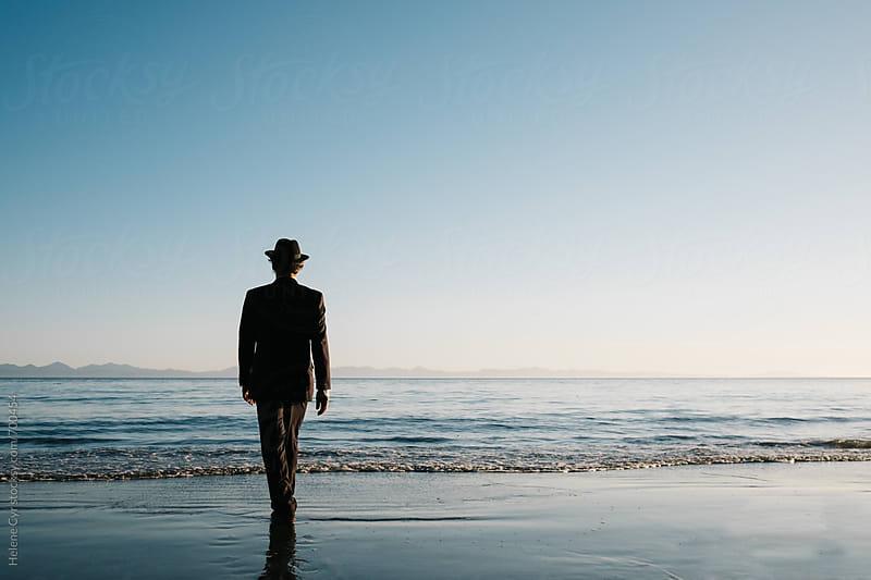Businessman Walking on Beach by Helene Cyr for Stocksy United