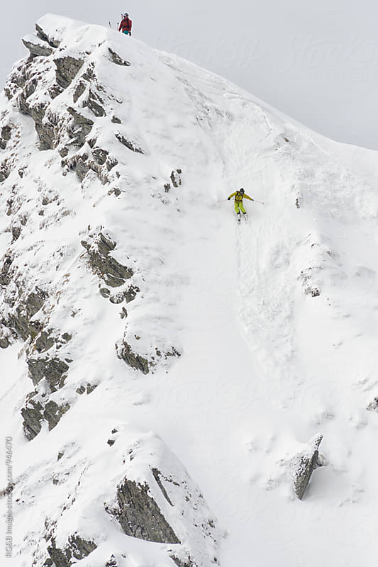 Man skiing down a snow couloir  by RG&B Images for Stocksy United