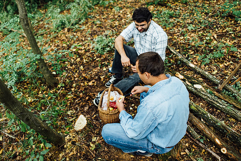 Men having a lunch in the woods by Boris Jovanovic for Stocksy United