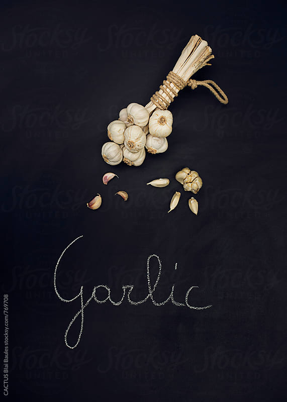Garlic on a chalkboard by CACTUS Blai Baules for Stocksy United