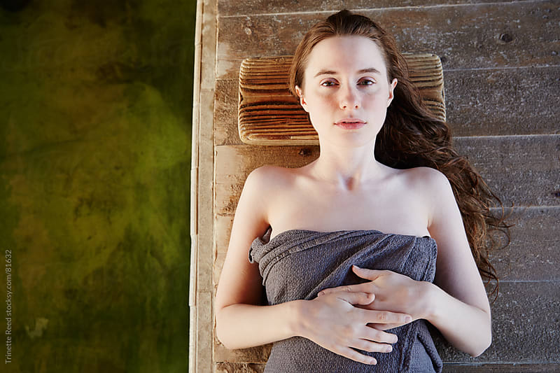 Woman lying down in Japanese Hot Springs & Spa by Trinette Reed for Stocksy United
