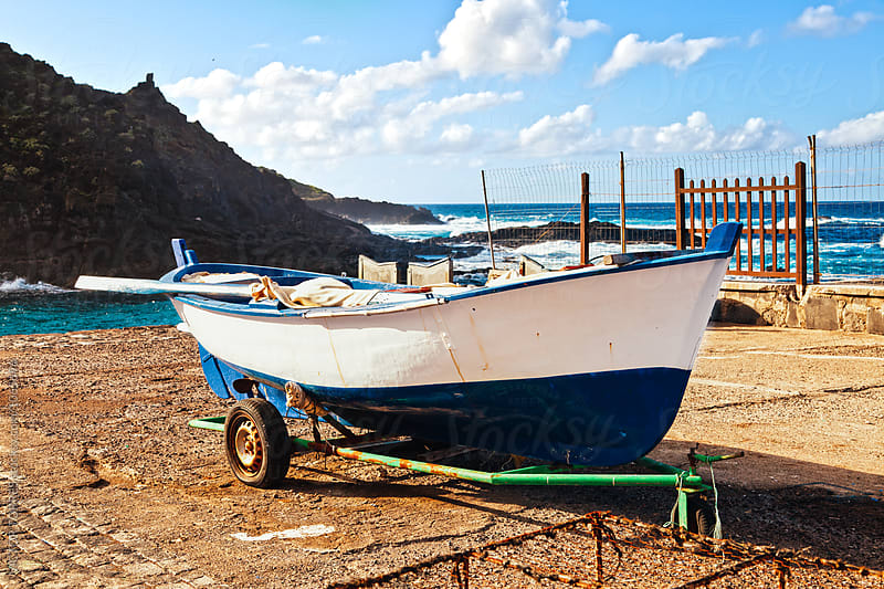 Old Rowboat in Garachico, Tenerife by VICTOR TORRES for Stocksy United