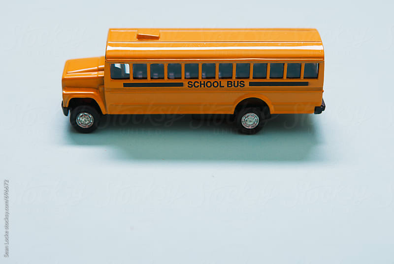 School Bus Metal Toy Vehicle From The Side by Sean Locke for Stocksy United