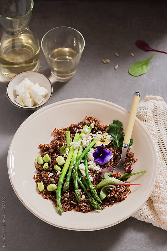 Red quinoa salad with asparagus and fava beans by Laura Adani for Stocksy United