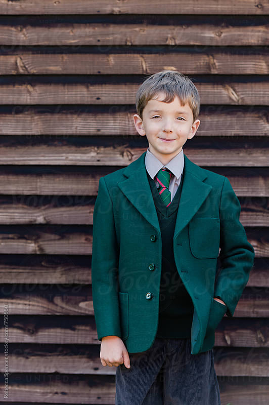 English school boy in his smart uniform by Rebecca Spencer for Stocksy United