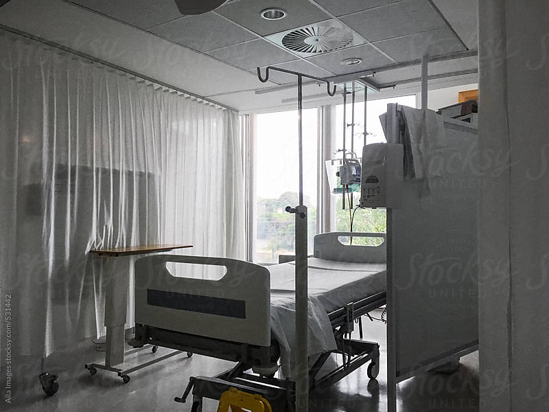 Empty Hospital Ward by Aila Images for Stocksy United