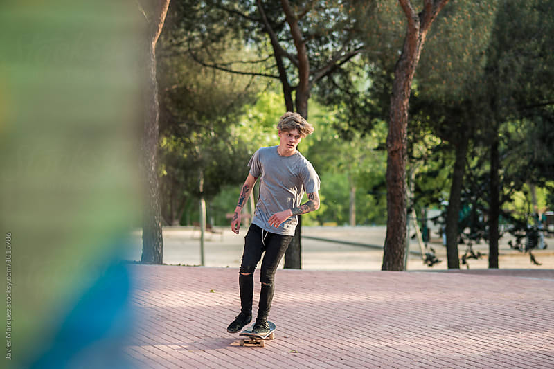 Young tattooed skater man by Javier Marquez for Stocksy United