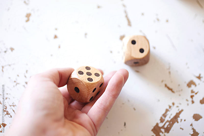 roll the dice by Natalie JEFFCOTT for Stocksy United
