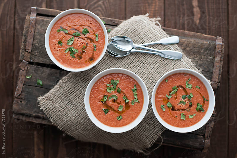 Food: Spanish Gazpacho, cold and refreshing tomato soup by Ina Peters for Stocksy United