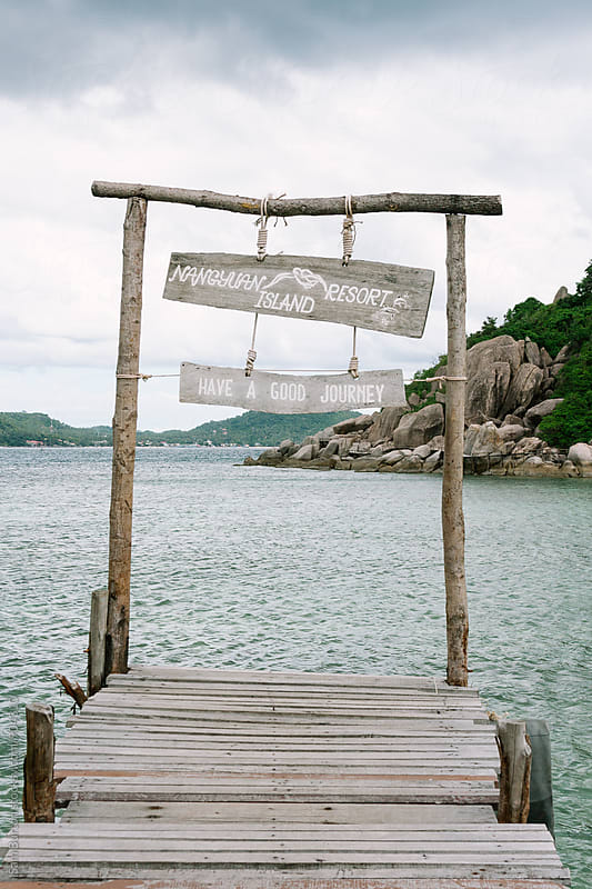 Pier with sign by Sam Burton for Stocksy United