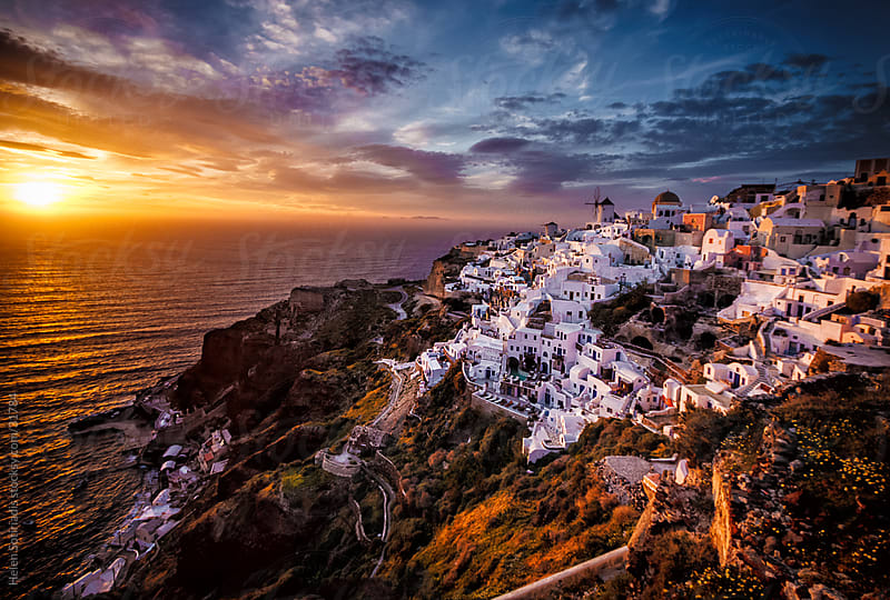 the town of oia, santorini, at sunset by Helen Sotiriadis for Stocksy United