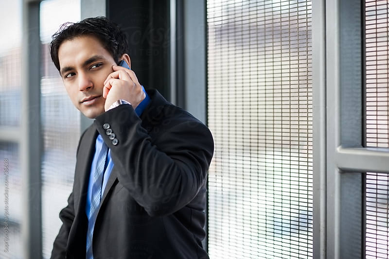 Indian businessman on the phone by Suprijono Suharjoto for Stocksy United