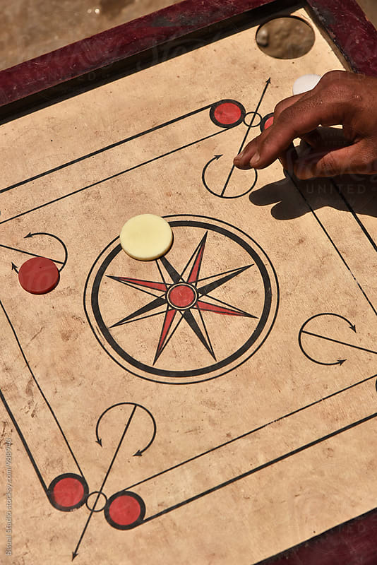 Children play carrom in Nepal by Bisual Studio for Stocksy United