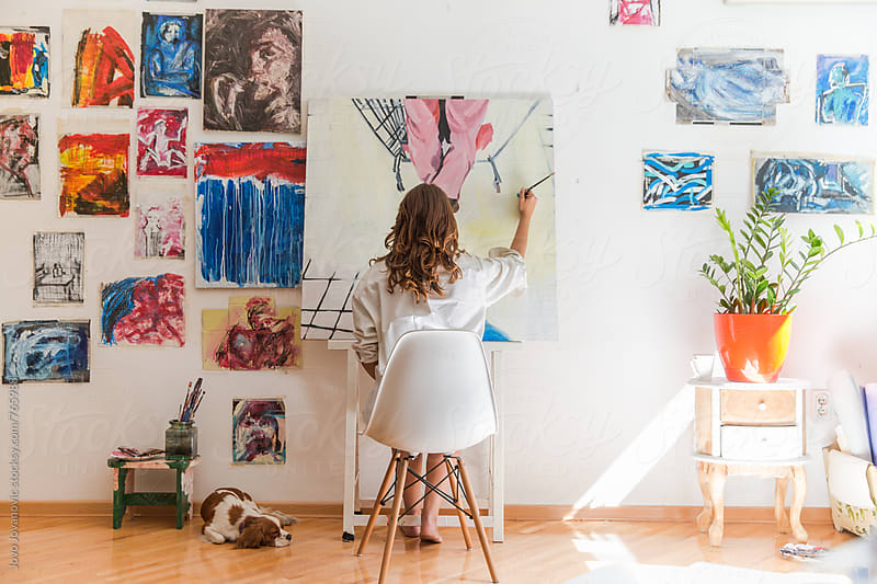 Female artist working on canvas in her home studio by Jovo Jovanovic for Stocksy United