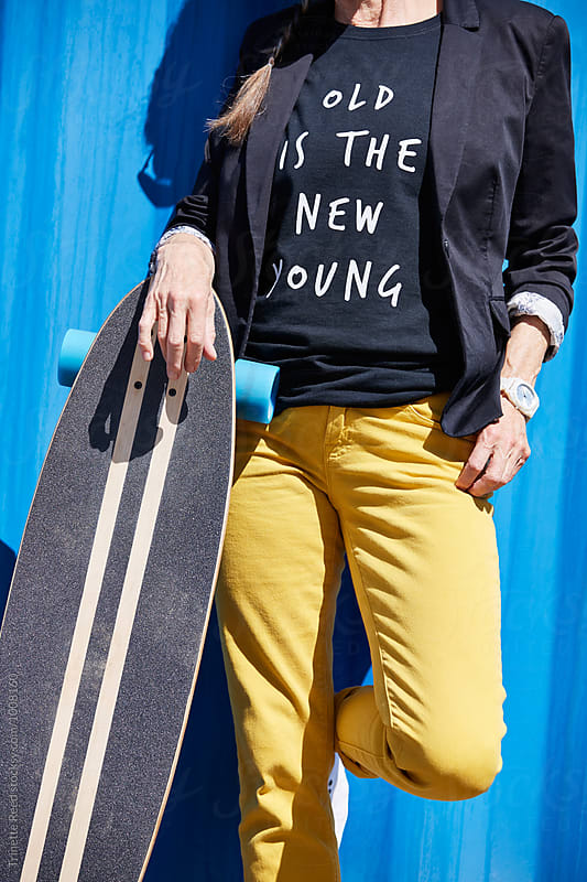 Hip and stylish senior woman with skateboard by Trinette Reed for Stocksy United