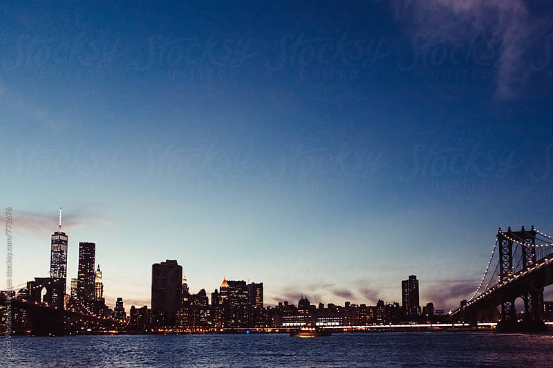 Manhattan at Night by Good Vibrations Images for Stocksy United