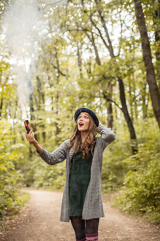Woman Playing With Smoke Bomb in Nature by Mosuno for Stocksy United