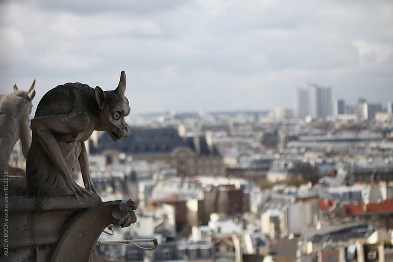 A Gargoyle Looking Down Over Paris France by ALICIA BOCK for Stocksy United