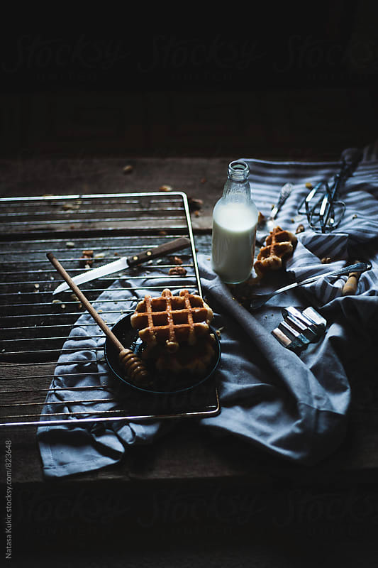 Waffles,honey and milk still life by Natasa Kukic for Stocksy United