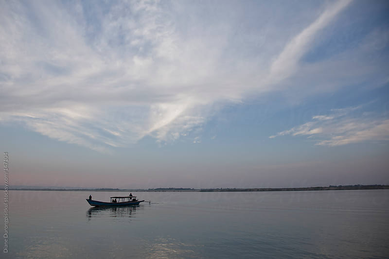 Boat on the Ayeyarwady river by Diane Durongpisitkul for Stocksy United