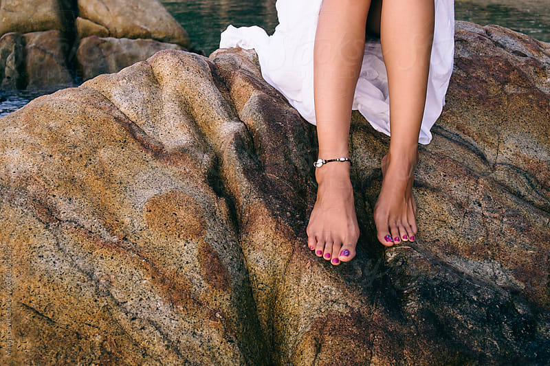Woman's Legs on the Rocky Shore by Marija Savic for Stocksy United