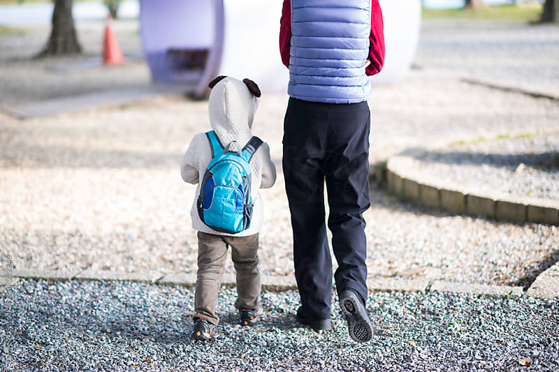 Father walking his little son to school by Lawren Lu for Stocksy United